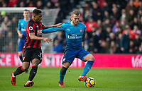 Jack Wilshere of Arsenal holds off Jordon Ibe of AFC Bournemouth during the Premier League match between Bournemouth and Arsenal at the Goldsands Stadium, Bournemouth, England on 14 January 2018. Photo by Andy Rowland.