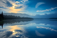 Reflection at sunrise on Lac La Joie<br />