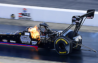Sept. 15, 2012; Concord, NC, USA: NHRA top fuel dragster driver Pat Dakin has a little fire up his back during qualifying for the O'Reilly Auto Parts Nationals at zMax Dragway. Mandatory Credit: Mark J. Rebilas-