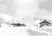 D&amp;RGW #487 turning for return to Chama.  Photo from west of depot toward wye switch.  Today was a snow-clearing operation at Cumbres, note the bulldozer near the depot.<br /> D&amp;RGW  Cumbres, CO  Taken by Richardson, Robert W. - 1/21/1949