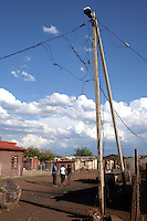 KHUTSONG, SOUTH AFRICA - OCTOBER 16: Evidence of illegal electricity connections on October 16, 2012, in Khutsong, South Africa. Khutsong, a black township. Is located about 56 miles west of Johannesburg, and surrounded by gold mines. Because of recent strikes many mineworkers has been fired which is making the poverty worse here. (Photo by Per-Anders Pettersson)