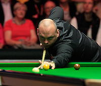 Stuart Bingham plays the cue ball of the cushion after a John Higgins safety shot during the Dafabet Masters Q/F 4 match between John Higgins and Stuart Bingham at Alexandra Palace, London, England on 15 January 2016. Photo by Liam Smith / PRiME Media Images