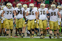 The offensive line heads to the ball.