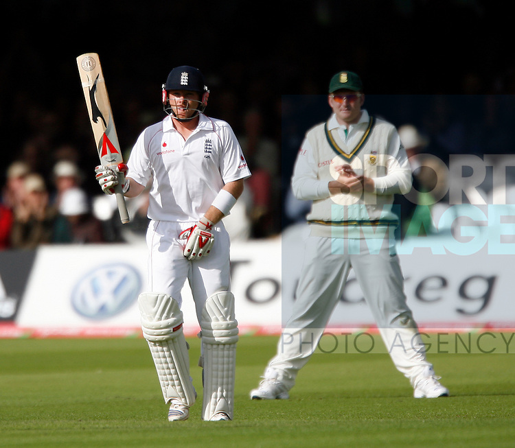 England's Ian Bell celebrates his 50 as South Africa's Graeme Smith looks on