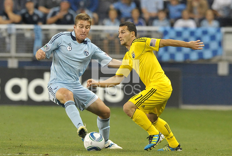Matt Besler Sporting KC defender faces Dilly Duka (yellow) Columbus Crew... Sporting Kansas City defeated Columbus Crew 2-1 at LIVESTRONG Sporting Park, Kansas City, Kansas.