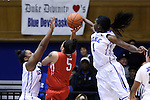 28 November 2014: Duke's Elizabeth Williams (1) blocks a shot by Stony Brook's Kori Bayne-Walker (5). The Duke University Blue Devils hosted the Stony Brook University Seahawks at Cameron Indoor Stadium in Durham, North Carolina in a 2014-15 NCAA Division I Women's Basketball game. Duke won the game 72-42.