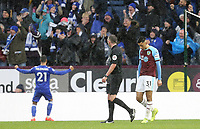 Burnley's Dwight McNeil looks dejected as Leicester City celebrate their winning goal scored by Wes Morgan (not pictured)<br /> <br /> Photographer Rich Linley/CameraSport<br /> <br /> The Premier League - Burnley v Leicester City - Saturday 16th March 2019 - Turf Moor - Burnley<br /> <br /> World Copyright © 2019 CameraSport. All rights reserved. 43 Linden Ave. Countesthorpe. Leicester. England. LE8 5PG - Tel: +44 (0) 116 277 4147 - admin@camerasport.com - www.camerasport.com