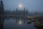 Idaho, South Central, Stanley. A setting moon in the pre-dawn light in the Bear Valley in autumn.