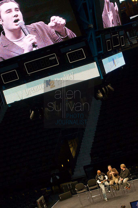 """Casting director Neal Konstantini (on video screen and seated middle) speaks on stage with former """"Real World"""" star Syrus (left) and Q100.5's Jeff Dauler during a Dreams N2 Reality show and casting call at Philips Arena in Atlanta on Saturday, August 4, 2007. People offered their auditions in hopes of gaining spots on game shows and others in the reality TV genre."""