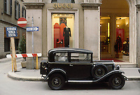 "- Milan, an old Fiat  ""Balilla"" car parked in front of Gucci shop in Montenapoleone street....- Milano, antica automobile FIAT ""Balilla"" parcheggiata in via Montenapoleone davanti al negozio Gucci"