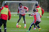 SWANSEA, WALES - JANUARY 28:  Bafetibis Gomis of Swansea City ( with ball ) makes his way past his team mates  on January 28, 2015 in Swansea, Wales.