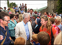 BNPS.co.uk (01202 558833)<br /> Pic: PhilYeomans/BNPS<br /> <br /> There was no escape for beleaguerd Labour leader Jeremy Corbyn even in the bucolic surroundings of the Tolpuddle Martyrs rally in the heart of Dorset.<br /> <br /> Labour Party member Claire Cavendish climbed a gravestone to deliver a vitriolic attack on the controversial leader, demanding he should step down, just after he had laid a wreath on a martyrs grave in the village churchyard.<br /> <br /> Jeremy Corbyn is a regular visitor to the famous rally that is seen as a key event in the founding of the Trade Union movement.