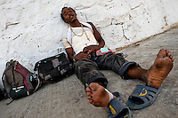 """A Honduran immigrant, wounded by a fall of the train, waits to catch the cargo train called 'La Bestia' (The Beast) on a train station in a border town of Arriaga, Mexico, 24 May 2011. Between 2010 and 2015, the US and Mexico have apprehended almost 1 million illegal immigrants from El Salvador, Honduras, and Guatemala. While the economic reasons remain the most frequent motivation for people from Central America to illegally immigrate to the US, thousands of Salvadorans, Guatemalans, and Hondurans, many of them minors, seek asylum in the US due to the thriving crime and gang-related violence in their region (known as the Northern Triangle). Taking an exhausting and risky journey, riding thousands of miles atop the cargo trains, facing a physical danger and extortion from the organized crime groups that control migrant routes, the """"undocumented"""" still flee to the US, looking for their American dream."""
