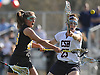 Alexandra Murphy #26 of Wantagh, left, takes a shot under pressure from Caroline Kiernan #25 of Cold Spring Harbor during a Nassau County varsity girls lacrosse gameat Cold Spring Harbor High School on Thursday, Apr. 21, 2016. Wantagh won by a score of 11-10.