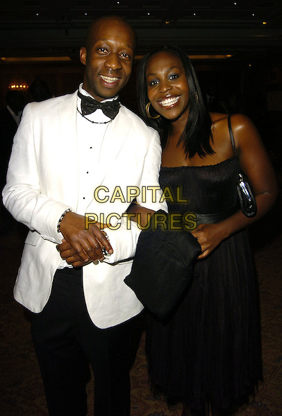 JOSEPH KPOBIE & PETRA LETANG.Gift Of Life VII Charity Dinner, Royal Lancaster Hotel, London, England, September 16th 2006..half length black dress.Ref: CAN.www.capitalpictures.com.sales@capitalpictures.com.©Can Nguyen/Capital Pictures