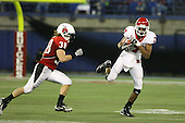 January 5th, 2008:  Rutgers wide receiver Tiquan Underwood (7) catches a pass in front of Ball State defender Alex Knipp (38) during the third quarter of the International Bowl at the Rogers Centre in Toronto, Ontario Canada...Rutgers defeated Ball State 52-30.  ..Photo By:  Mike Janes Photography
