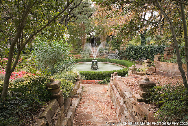 The Dragon Fountain and  pool in the lower garden can be seen from several angles including a view along one of the approaching paths at the Douglas Chandor Garden in Weatherford, Texas.