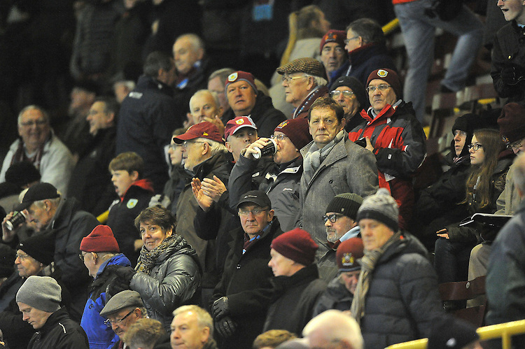 Burnley fans<br /> <br /> Photographer Dave Howarth/CameraSport<br /> <br /> Football - Barclays Premiership - Burnley v Newcastle United - Tuesday 2nd December 2014 - Turf Moor - Burnley<br /> <br /> &copy; CameraSport - 43 Linden Ave. Countesthorpe. Leicester. England. LE8 5PG - Tel: +44 (0) 116 277 4147 - admin@camerasport.com - www.camerasport.com