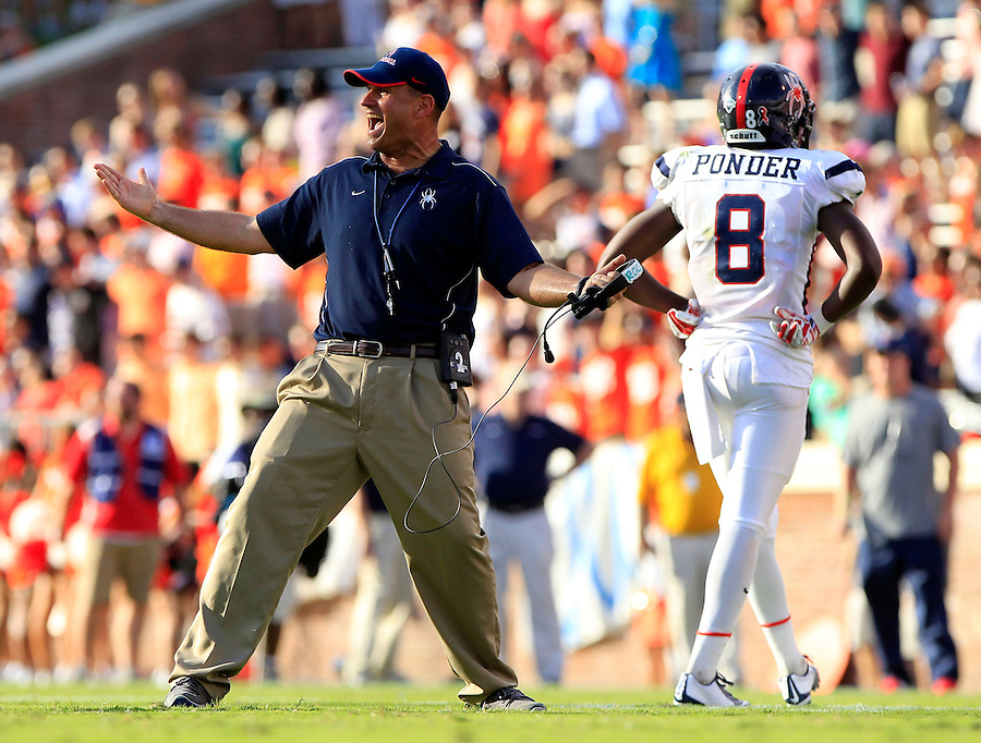 Richmond head coach Danny Rocco reacts to a call during the third quarter of the game Saturday Sept. 6, 2014 at Scott Stadium in Charlottesville, VA. Virginia defeated Richmond 45-13. Photo/Andrew Shurtleff