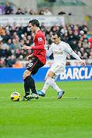 Sunday, 23 November 2012<br /> <br /> Pictured: Robin van Persie of Manchester United is challenged by Leon Britain of Swansea City<br /> <br /> Re: Barclays Premier League, Swansea City FC v Manchester United at the Liberty Stadium, south Wales.