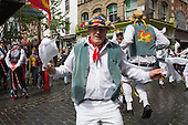 London, UK. 10 May 2014. Morris Men from Wantage dancing in Gerrard Street/Chinatown.  Morris Dance groups from all over England gathered in London and performed for the public during the Westminster Morris Men Day of Dance.