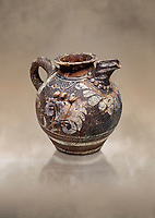 Minoan Kamares Ware ewer jug with polychrome decorations , Phaistos 1800-1700 BC; Heraklion Archaeological  Museum.<br /> <br /> This style of pottery is named afetr Kamares cave where this style of pottery was first found