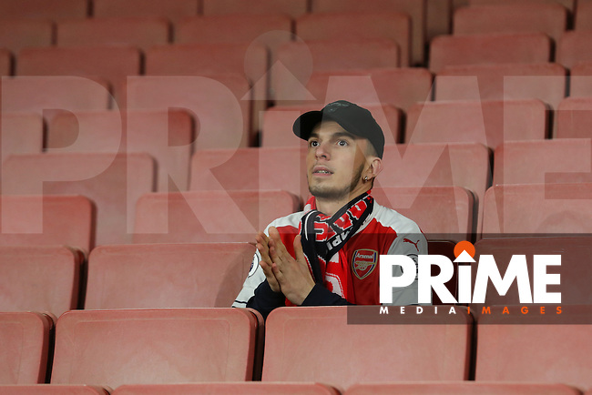 A lone Arsenal fan ahead of the UEFA Champions League match between Arsenal and Paris Saint Germain at the Emirates Stadium, London, England on 23 November 2016. Photo by David Horn.