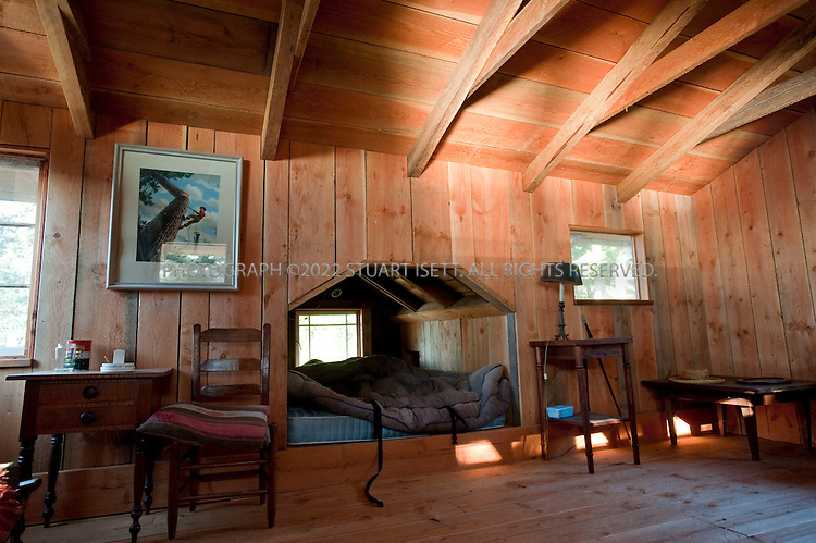 12/9/2009--San Juan Islands, WA, USA.<br /> <br /> Nick Fahey, 66, lives alone in the cabin his father started building in 1939 in the San Juan Islands in Washington. Fahey's father bought the land in 1930 and started building the cabin in 1938 but Mr. Fahey continues to add to the home. He has lived permanently on the island since 1992. He has a son living in France and a  daughter living in Seattle, WA.<br /> <br /> The home is powered by 2 solar panels which charge a few lights and help to keep his mobile phone charged. Heat, including for water, comes from burning wood, which is abundance on the property. Mr. Fahey 'commutes' to the nearby town of Anacortes on his 1926 fishing boat, the 'Veteran', which he restored; unlike many of the islands in the San Juans, the island has no ferry service. The trip takes about an hour and is where Mr. Fahey buys supplies, checks his post box and visits his 99 year old father who lives in an assisted living home there.<br /> <br /> &copy;2009 Stuart Isett. All rights reserved.