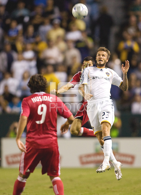 LA Galaxy midfielder David Beckham goes high for a ball. The LA Galaxy defeated the Chicago Fire 1-0 at Home Depot Center stadium in Carson, California on Friday October 2, 2009...