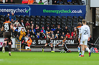 Ollie Watkins of Brentford celebrates scoring the opening goal during the FA Cup Fifth Round match between Swansea City and Brentford at the Liberty Stadium in Swansea, Wales, UK. Sunday 17 February 2019
