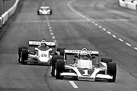 HAMPTON, GA - APRIL 22: Tom Sneva (#1 McLaren M24/Cosworth TC) drives ahead of Gordon Johncock (#20 Penske PC6/Cosworth TC) during the Gould Twin Dixie 125 event on April 22, 1979, at Atlanta International Raceway near Hampton, Georgia.