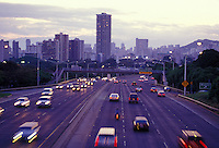 Cars rush by at sunset on H1 freeway near Kapiolani Blvd, Honolulu, Hawaii