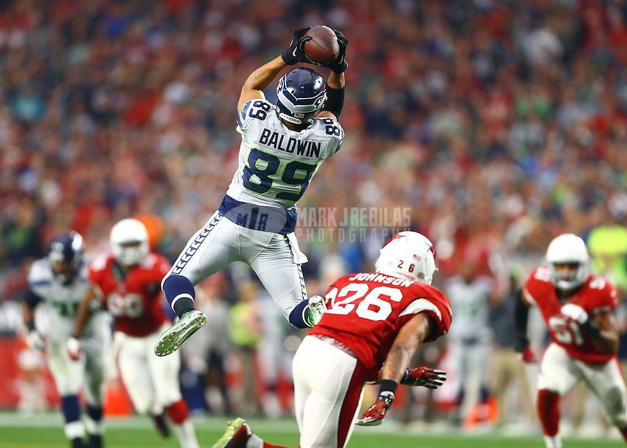 Jan 3, 2016; Glendale, AZ, USA; Seattle Seahawks wide receiver Doug Baldwin (89) leaps to catch a second quarter pass against the Arizona Cardinals at University of Phoenix Stadium. Mandatory Credit: Mark J. Rebilas-USA TODAY Sports