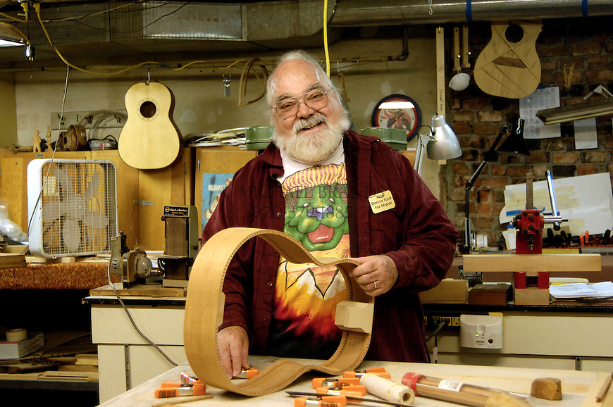 Former Mayor Bud Ford in the basaement workshop where he makes guitars and dulcimers. The store is called The Dulcimer Shop. Michael Brands for The New York Times.