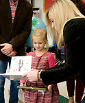 WATERTOWN, CT-121817JS01---Nora Stentiford, a kindergarten student at John Trumbull Primary School in Watertown, is presented with a framed copy of the holiday card she created, by Watertown Public Schools Superintendent Dr. Bridget Carnemolla, right, after being named the winner of the 3rd annual holiday contest during a small ceremony Monday at the school. The card will be sent out as this years district holiday card. <br /> Jim Shannon Republican-American