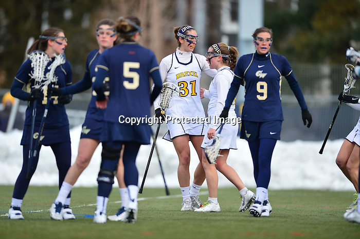 PHILADELPHIA - The Drexel women's lacrosse team opened its season with a resounding victory on Sunday afternoon, heating up a chilly day at Vidas Field with some strong offensive production by two of its senior leaders. Kelly Palace scored five goals and Amanda Norcini added four as Drexel got a win in its first game under newly-minted head coach Hannah Rudloff.<br /> <br /> The Dragons (1-0) outshot George Washington (1-1) 29-15 for the day, and controled play nearly the entire way. After scoring the first goal of the afternoon, the Dragons ceded the lead briefly as the Colonials netted the next two. Drexel responded with a 5-0 run to take a 6-2 lead with 8:18 remaining in the first half. The Dragons would not look back from there.<br /> <br /> Norcini got the game's first tally just over three minutes into the action. After Allie Rash and Jamie Bumgardner each scored for George Washington over the next three minutes, the Dragons shook off the rust and took control. Palace notched her first score of the season at the 22:51 mark in the first half. She would add two more during the Dragons' 5-0 run, as well as two second-half goals that left Drexel with a 10-4 advantage with 11:07 to play. The big game was a welcome sight for Drexel fans, who saw Palace suffer a season-ending injury midway through last season after scoring 16 goals in her first 10 contests.<br /> <br /> Eva Winiarski connected for her first collegiate goal just under nine minutes into the game. Her score gave Drexel a 3-2 lead, and put the Dragons ahead for good. Emily Duffey, who tallied 10 goals during her freshman campaign, also scored a first-half goal for the Dragons.<br /> <br /> Coming out of the break up 6-3, Drexel scored the first three goals of the second half to further cement their lead. Norcini's second made it 7-3 just 1:55 into the period, followed by Palace's fourth. Norcini made it a hat trick with her third goal, the eventual game-winner, at the 25:49 mark.