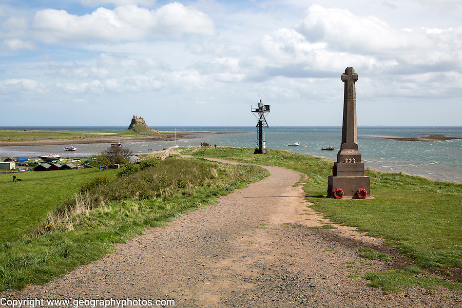 War memorial and castle, Holy Island, Lindisfarne, Northumberland, England, UK