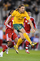 MELBOURNE, AUSTRALIA - OCTOBER 14: Joshua Kennedy from Australia in the air in a AFC Asian Cup 2011 match between Australia and Oman at Etihad Stadium on October 14, 2009 in Melbourne, Australia. Photo Sydney Low www.syd-low.com