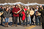 Mohawk drummers singing as a group  blockade the road as part of a demonstration to Defend our Climate in Oka, Quebec, Canada. The rally was held in Oka on traditional Mohawk territory and coincided with over 130 events across Canada as part of a National day to Defend our Climate.