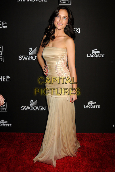 MINKA KELLY.Attending the 12th Annual Costume Designers Guild Awards held at the Beverly Hilton Hotel.  .Beverly Hills, California, USA,  .25th February 2010 .arrivals full length beige dress long maxi corset strapless ruched gold pleated hand on hip lace-up .CAP/ADM/BP.©Byron Purvis/AdMedia/Capital Pictures.