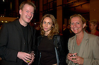 French actress Emanuelle Beart(M)  who is the President of the 25th  World Film Festival's  Jury  for a photo  with two unidentified guests (L & R)  at  the Party of the German Delegation , August 26th, 2001<br /> in Montreal, CANADA<br /> <br /> Brought up on a farm in Provence because her father, French singer and poet Guy BÈart didn't want her to be affected by the glamour world of Paris showbusiness, Emmanuelle BÈart nevertheless got the acting urge in early adolescence. At age 15, after a couple of bit parts, she came to Montreal as an au pair to learn English. Back in France, after acting lessons and few small roles in television, she made her big-screen breakthrough in the title role of Claude Berri's Pagnol adaptation, MANON OF THE SPRING (1986). A year later she made her Hollywood debut in Tom McLoughlin's DATE WITH AN ANGEL. She has since played for some of the premier directors on both sides of the Atlantic: Rivette (LA BELLE NOISEUSE, 1991), Sautet (NELLY AND MR. ARNAUD (1995), Chabrol (L'ENFER,1994), De Palma (MISSION: IMPOSSIBLE, 1996) and Ruiz (TIME REGAINED, 1999). She stars in Catherine Corsini's REPLAY, showing at this year's Festival.<br /> <br /> Photo by Pierre Roussel / Getty Images (On Spec)<br /> <br /> NOTE : Nikon D-1 JPEG opened with QUIMAGE ICC profile , saved as Adobe RG 1998 color space.