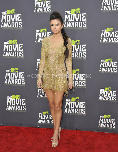 WWW.ACEPIXS.COM....April 14 2013, LA......Selena Gomez arriving at the 2013 MTV Movie Awards at Sony Pictures Studios on April 14, 2013 in Culver City, California. ....By Line: Peter West/ACE Pictures......ACE Pictures, Inc...tel: 646 769 0430..Email: info@acepixs.com..www.acepixs.com