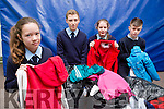 Mia Key, John Curtin, Hillary O'Connor and Thomas Fleming who are looking for people to donate old clothes for the Currow National School clothes collection on Tuesday