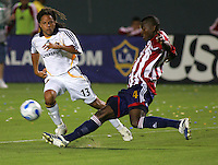 Chivas midfielder Shavar Thomas (4) clears the ball away from advancing LA Galaxy midfielder Cobi Jones (13). CD Chivas USA defeated the LA Galaxy 3-0 in the Super Classico MLS match at the Home Depot Center in Carson, California, Thursday, August 23, 2007.