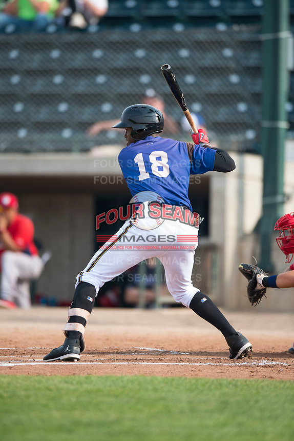 Missoula Osprey center fielder Kristian Robinson (18) at bat during a Pioneer League game against the Orem Owlz at Ogren Park Allegiance Field on August 19, 2018 in Missoula, Montana. The Missoula Osprey defeated the Orem Owlz by a score of 8-0. (Zachary Lucy/Four Seam Images)