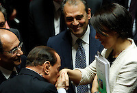 L'ex Presidente del Consiglio Silvio Berlusconi bacia la mano al Ministro delle Politiche Agricole e Forestali Nunzia De Girolamo durante il voto di fiducia sul nuovo governo al Senato, Roma, 30 aprile 2013..Italian former Premier Silvio Berlusconi kisses the hando to Agriculture Minister Nunzia De Girolamo during a confidence vote on the government at the Senate in Rome, 30 April 2013..UPDATE IMAGES PRESS/Riccardo De Luca