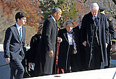 United States President Barack Obama and Former U.S. President Bill Clinton help Ethel Kennedy, widow of former U.S. Attorney General and U.S. Senator Robert F. Kennedy (Democrat of New York) up a set of steps as they prepare to lay a wreath at the gravesite for President John F. Kennedy at Arlington National Cemetery in Arlington, Virginia, November 20, 2013. This Friday will mark the 50th anniversary of the assassination of President Kennedy. Jack Schlossberg, son of U.S. Ambassador to Japan Caroline Kennedy and grandson of President Kennedy, is at the left of the frame.<br /> Credit: Pat Benic / Pool via CNP