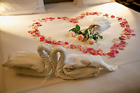 Switzerland. Geneva. Hotel Métropole. Wedding. Honeymoon Bed Suite decorated with swan towels, roses petals' heart and bouquet of roses. 9.11.13 © 2013 Didier Ruef