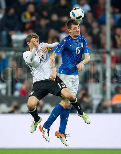 29.03.2016. Munich, Germany. International soccer match between Germany and Italy, at the Allianz Arena in Munich.  Thomas Mueller (Ger) and Francesco Acerbi (Ita).