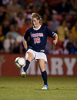 Emily Sonnett (16) of Virginia passes the ball forward during the game in College Park, MD.  Maryland defeated Virginia, 3-1.